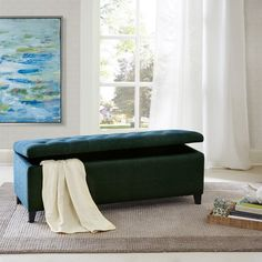 This modern storage ottoman accentuated with button tufting provides ample storage and features an elegant peacock blue fabric with rich espresso legs. No assembly requiredFeaturesColor: BlueMaterial: Bench: x x S Modern Storage Bench, Entryway Bench Storage, Upholstered Storage Bench, Storage Spaces, Bedroom Bench With Storage, Bedroom Benches, Bedroom Decor, Bedroom Ideas, Green Bedding
