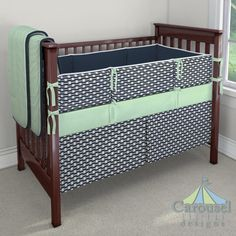 Crib bedding in Solid Navy, Navy Tomahawk Stripe, Solid Mint, Solid Mint Minky. Created using the Nursery Designer® by Carousel Designs where you mix and match from hundreds of fabrics to create your own unique baby bedding. #carouseldesigns