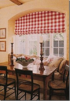Country French Dining Area with a bold red and white buffalo check valance.  pale butter yellow walls, antique table and chairs
