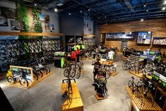 Cycling Sports Group Uses Graphics to Enhance Their Brand Interior Design And Technology, Shop Interior Design, Retail Design, Store Design, Motocross Store, Cannondale Bikes, Tennis Shop, Bicycle Store, Cycle Shop