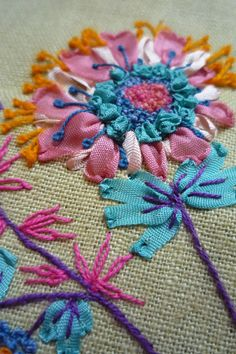 If you go to her site shhe has many more albums on this and others but ore like this in beautiful bright colors mixing ribbon and regular enbroidery