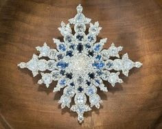 The Sapphire Jubilee Snowflake Brooch that Queen Elizabeth II received from Canada to mark her 65 years on the throne. July 19 2017
