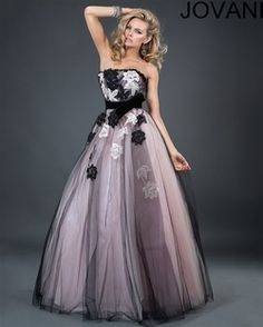 Jovani 171240 Colors: Black/Blush Retail price: $640.00          Our price: $450.00 Jovani sexy long strapless gown features beautiful floral appliqué, a velvet waist belt with a bow and beautiful tulle overlay with a sexy A-line skirt. This beautiful long gown is a suitable guest dress for a formal evening event. www.srdlooks.com