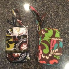 2 Vera Bradley wallets. Being sold together., Holds some smart phones, not all. Credit card slots, Wristlet. Pre-loved Vera Bradley Bags Clutches & Wristlets