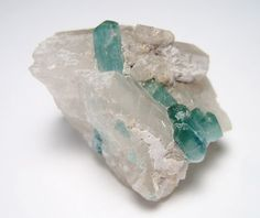 Collectors Special---a beautiful Paraiba blue tourmaline specimen on quartz from Afghanistan. The crystals are terminated, and the specimen shows no signs of damage. It measures 40.8mm long by 36.4mm wide by 25mm deep and weighs 25.1 grams or 125.5 carats. The measurements and weight put it into the miniature size category.  If you buy anything from me and are not satisfied, my return policy is very clear. No questions asked. Just return the item unused and undamaged, and I will refund you…
