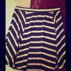 Fun and flirty striped skirt💞 Grey and white striped skirt. New never worn without tags. Has a pretty flow to it. Skirts