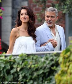 What a couple! The pair were the epitome of an A-list supercouple as they mingled with the revellers on the terrace of his stunning estate overlooking the water