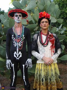 Classic take on Frida Kahlo!  Love how he is in a creative Dia de Los Muertos / #skeleton to compliment Frida  ||  Couples #Halloween #Costumes