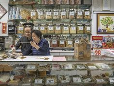 Photographer Marcel Heijnen was walking around his new neighborhood of Sai Ying Pun in Hong Kong when he noticed an adorable trend in many of the traditional shops.