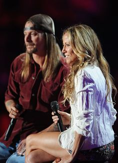 Kid Rock Photos Photos - Musicians Kid Rock and Sheryl Crow perform on stage at the 2011 CMT Music Awards at the Bridgestone Arena on June 8, 2011 in Nashville, Tennessee. - 2011 CMT Music Awards - Show
