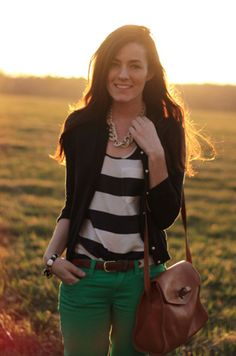 Striped or patterened black and neutral shirt + black cardigan + green skinnies + cognac purse + gold necklace