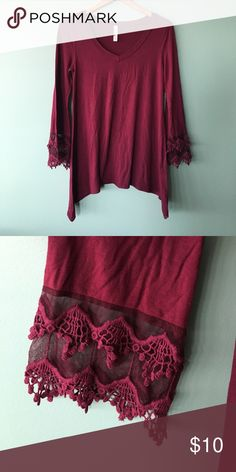 Asymmetrical Tunic size small Looks amazing with leggings! Asymmetrical hemline and adorable sleeve detailing. Never worn. color is wine red or burgundy. Tops Tunics