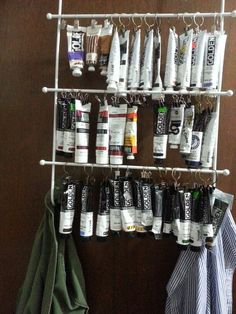 I love storing my tubes of paint this way.easy to see what I need! I used n over the door towel rack and bull dog clips and cafe curtain clips.