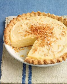 Coconut Custard Pie    This recipe for coconut custard pie uses a combination of coconut milk and whole milk to create the creamy filling. Instead of the usual whipped cream topping, garnish the pie with toasted shredded coconut to let the custard star on your Thanksgiving dessert table.