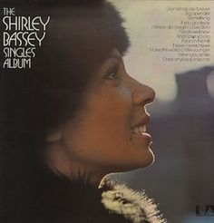 "Shirley Bassey, The Shirley Bassey Singles Album***: She does have an incredible voice which is one of the reasons (I'm sure) that she was selected to sing ""Goldfinger."" But it's just the voice. See, though I like covers, I prefer people who can make original work blast off. Though there are some originals on this one, all of it sounds like it was originated from someone else. And though this is very good, it still isn't quite what I'm looking for. 7/9/15"