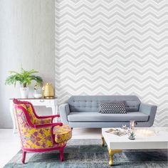 Geometric Chevron Wallpaper in grey, silver and white. Glamorise your home with geometric patterned wallpaper. Complimentary glitter features play make this wallpaper particularly classy and attractive. The on trend bold designs create an eye catching effect. A calm and collected colour scheme of grey, silver and white really allows the shapes and glitter to take centre stage. Click to shop for yours now.