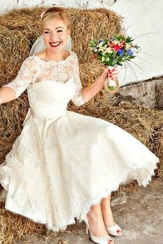 Dana Bolton tea length lace wedding gown with sleeves