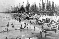1960s photograph--Huntington Beach, CA in the shade of the oil rigs.