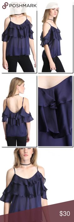 """Satin Layer Ruffled Cold Shoulder Top Details Classy and confident, this satin top by Sugar Lips is the sophisticated statement piece you need this season for any event. With its cold shoulders, layered ruffles, V-back, adjustable shoulder straps, and stormy color, this tank is a must-have!   Satin cold shoulder top Layered ruffle details Adjustable shoulder straps V-back Navy Hand wash cold, tumble dry low 100% polyester Measures approximately 26"""" from shoulder Model shown wearing size…"""