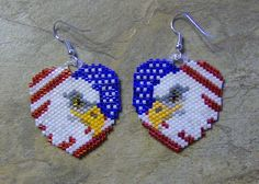 These pretty national heart earrings are done in the brick stitch with size 11 delica glass beads. The colors that I have used are blue, pearl, red, light orange, white, steel grey, crystal charcoal, gold, pale grey, crystal, silver lined marigold, gun metal, and linen. They measure 1 1/2 long. The designer is Beadintrigue. I do all of my own bead work one bead at a time. Thank you for looking at my bead work. Have a blessed day.