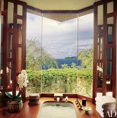"""The tub in the master bath is surrounded by maka, a tropical hardwood """"similar to teak,"""" says Tuttle 