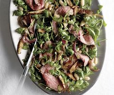 Grilled Steak and Arugula Salad with White Beans and Shiitake ~ Peppery arugula, earthy mushrooms, caramelized onions, and white beans make a luxurious bed for leftover flank steak.