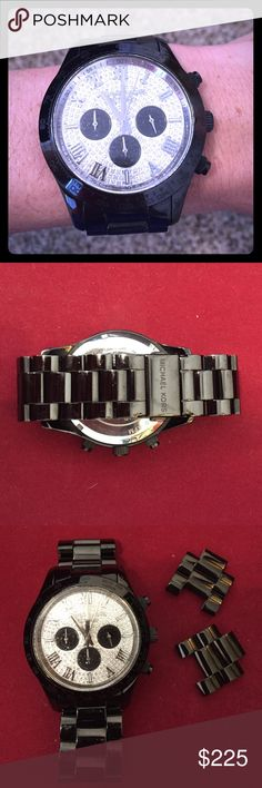 Authentic Michael Kors Layton pavé glitz watch Black watch with silver crystals. Lightly worn, but still a statement piece! Bought brand new for $550. I've never seen another person wearing this watch. One of a kind! MICHAEL Michael Kors Accessories Watches