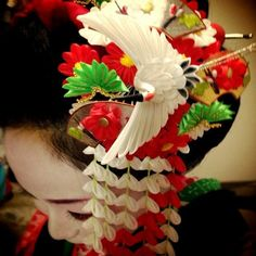 Maiko Kei of Nagoya city presenting her kanzashi for January/February - a crane, red and white flowers, pine and gold fans.