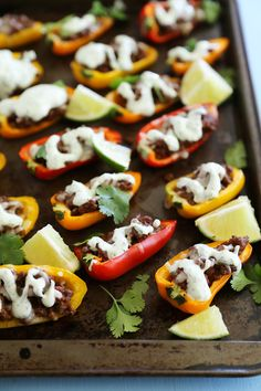 Mini Taco Stuffed Peppers with Cilantro Cream Sauce - Easy 5-ingredient spicy taco stuffed peppers with a creamy cool sauce. Thecomfortofcooking.com