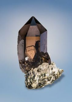 Smoky Quartz - 260€	 Val Giuv, Sedrun, Vorderrhein, Tujetsch, Graubünden, Switzerland	 Size: 6.1 x 3.7 x 2.4 cm	 This crystal is very gemmy and composed entirely of the best quality you can look for.