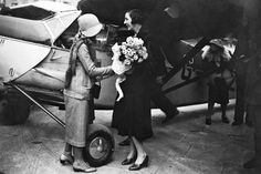 British pilot Amy Johnson, right, was welcomed by her mother at Croydon Aerodrome, England, on Sep. 9, 1931 after flying to Japan in record time.
