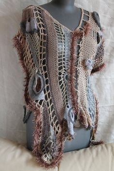 Boho Chic Hippie Chunky Freeform Crochet Vest - Sweater - Wearable Art - OOAK This is an exclusive Vest , performed in technique Freeform and Hyperbolic crochet . Suitable for any size up to XXL. On the side is tied to the tape. Care instructions: hand wash gently in cool water and lay flat to dry.
