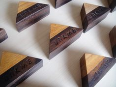 Unkme card holder. This is our first product. We use two materials, waru for the light one and sonokeling for the dark one. Both of them are in the natural colour with finished doff. Also, we do laser engrave for our mark. You can use it for name cards, photos and postcards. Dimension : 8 x 5 x 3 cm.