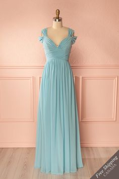 Laticia Blue #boutique1861 / This lovely evening gown will satisfy your desires for elegance and refinement. The delightful details of the pleated bodice and the off-shoulder sleeves are in line with the graceful style of this dress. The padded cups and boning in the bodice help in creating a perfect fit.