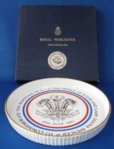 This is a fun British royal commemorative item made for the royal wedding in 1981 of Prince Charles and Lady Diana Spencer by Royal Worcester, England. The item is a shortbread baking dish in it's ori