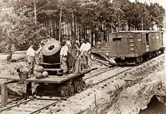 Soldiers with cannon on small railroad car. It was taken between 1861 and 1865.