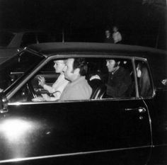 Elvis and Priscilla sitting together in the backseat with Joe Esposito and Joan