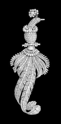 Bird Brooch, Cartier Paris, special order, 1948. Platinum, white gold, one emerald-cut diamond of 2.76 carats, two square-cut diamonds of 2.35 and 1.29 carats, and, respectively, 991 baguette-, brilliant- and fancy-cut diamonds weighing 83.89 carats in total The exceptional dimensions (20.20 cm long, weighing 156.45 g) make this brooch a unique post-war piece of high jewelry.