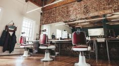 Here's an awesome collection of stylish barber shop interior design ideas. These are truly stunning and designed in a masculine look that creates a manly and stylish barber shop environment. Barber Shop Interior, Hair Salon Interior, Shop Interior Design, Brick And Wood, Salon Business, Estilo Retro, Barber Chair, Shop Interiors, Great Hair