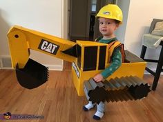 Steven: Our son is in love with construction equipment and his favorite thing is the excavator. My creative wife built the costume by hand out of cardboard, tape, and some spray. Halloween Infantil, Toddler Boy Halloween Costumes, Homemade Halloween Costumes, Halloween Costume Contest, Baby Halloween, Diy Toddler Costume, Dinosaur Halloween Costume, Construction For Kids, Construction Birthday Parties