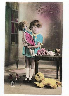 Lovely tinted vintage postcard - girl with doll