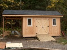 A 8' x 12' Garden & Storage shed with an 8' overhang for firewood storage. Â Clad with Eastern white pine board and batten. Â The Shed has a continuous ridge beam (3 2x8's site built) that cantlevers...
