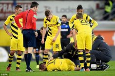 Reus (bottom) has been ruled out until the New Year after injuring himself against SC Paderborn on Saturday