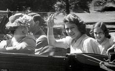 Rehearsing the wave! The Queen (then Princess Elizabeth) looks happy and carefree on a car trip round the grounds of Windsor Castle with her mother Queen Elizabeth (left), father King George VI, and sister Margaret (right) Princess Elizabeth, Princess Margaret, Queen Elizabeth Ii, Margaret Rose, Archive Footage, Royal King, Prince Phillip, Queen Mother, Windsor Castle