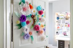 Colorful handmade flowers set the tone for Isabelle's crafty bedroom.