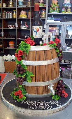 3D Wine Barrel shapd Wicked Chocolate cake, decorated with fondant grapes, roses, barrel tap, 3D #30 & 3D Wine personalised wine bottle | by Charly's Bakery