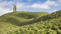 Discover the National Trust's Glastonbury Tor, Somerset. Steeped in history and legend, the Tor is a fascinating place to visit. Glastonbury Tor, National Trust, Somerset, Monument Valley, Past, Places To Visit, Country Roads, Tours, History