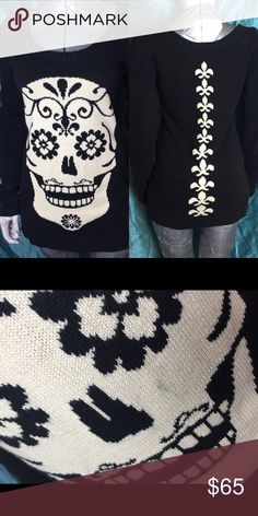 Betsey Johnson Sugar Skull sweater Betsey Johnson black and white sugar skull sweater. Has one small stain on the face of the skull, pictured. This thing haunts my dreams. But it's super comfy. Also I haven't worn it in years so. Goodnight, sweet prince. It's a small but will fit up to a large as far as I know. Betsey Johnson Sweaters