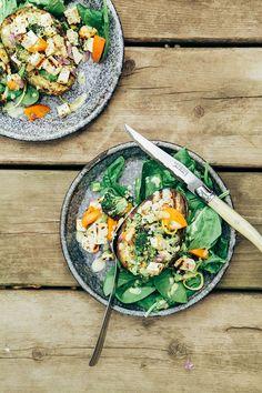 charred broccoli + tofu stuffed avocados with  sweet lemon curry sauce
