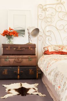 Old leather trunk does double duty as a bedside table